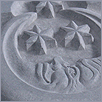 The Moon gablestone carved in bluestone
